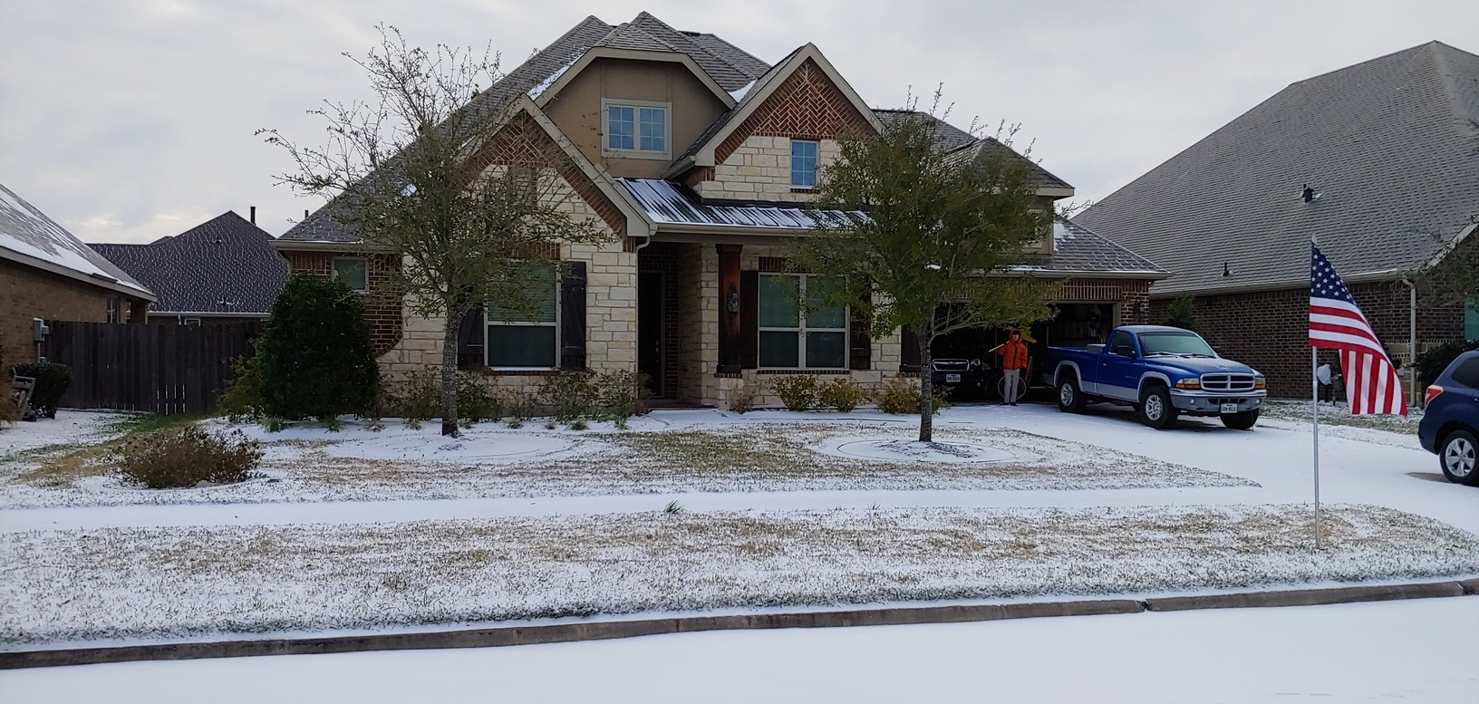 Our house with snow on the ground and Wilson in the garage